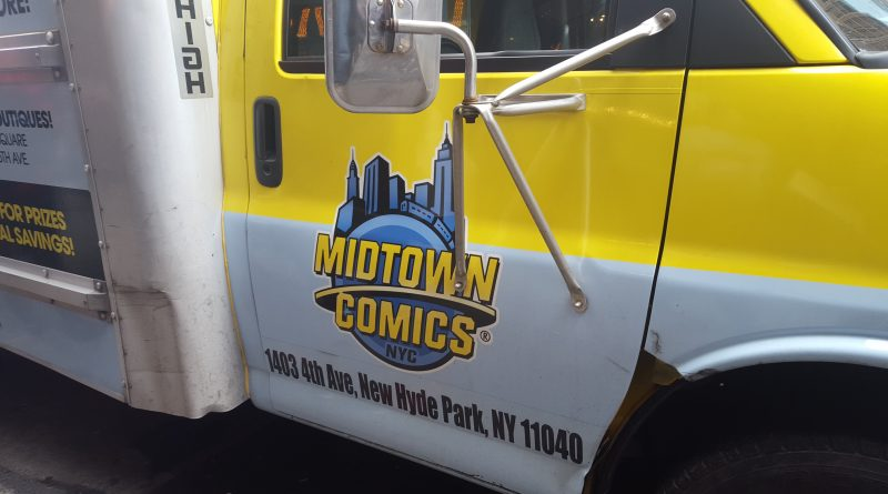 The Midtown Comics Truck parked in front of it's store filled with boxes of free comics. Photo Credit: Anthony Medina